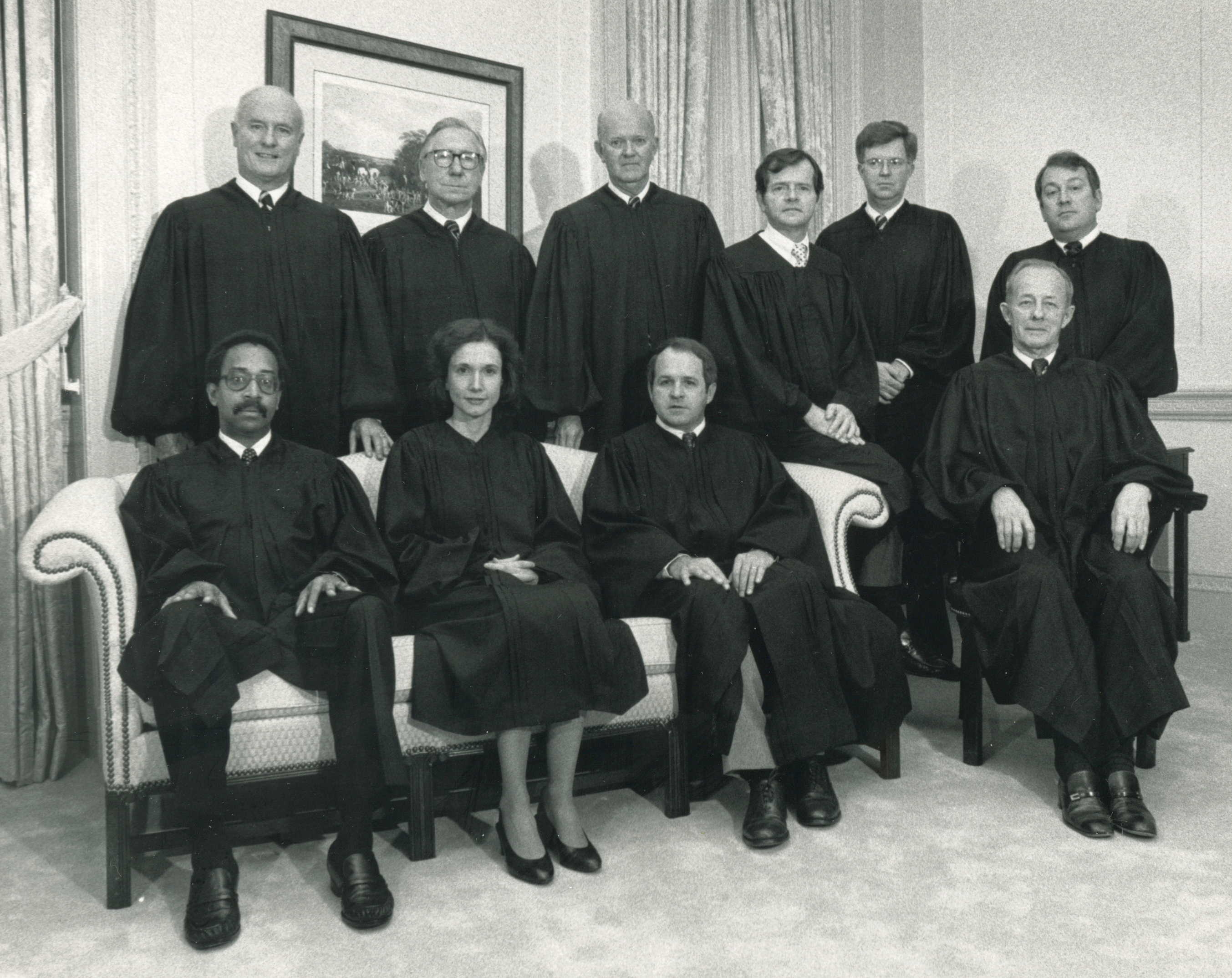 Court of Appeals of Virginia, 1985. Front row, left to right: Hon. James W. Benton, Jr., Hon. Barbara Milano Keenan, Hon. Sam W. Coleman, III; Back row, left to right: Hon. Charles H. Duff Hon. Joseph E. Baker, Hon. William H. Hodges, Hon. Bernard G. Barrow, Hon. Norman K. Moon, and Hon. E. Ballard Baker (Chief Judge).