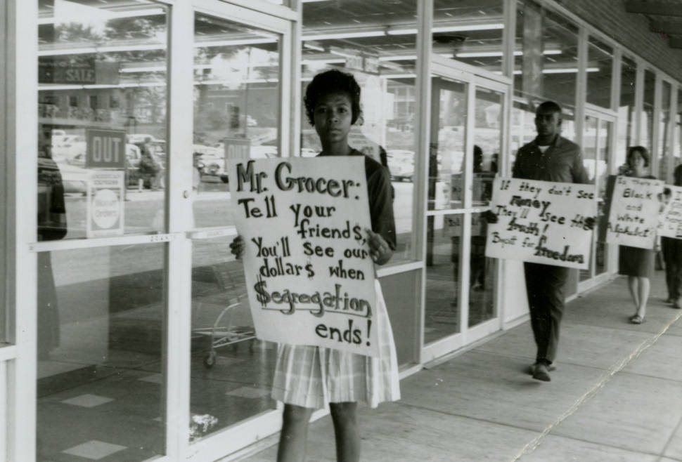 Protestors Darwyn White Dix, foreground) at W.T. Grant department store, Farmville, Va., August 24, 1963, a year before the Supreme Court held school closings unconstitutional in Griffin v. County School Board of Prince Edward County, 377 U.S. 218, 1964. Courtesy of VCU Libraries.